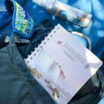 Reisetagebuch am Strand in Tasche