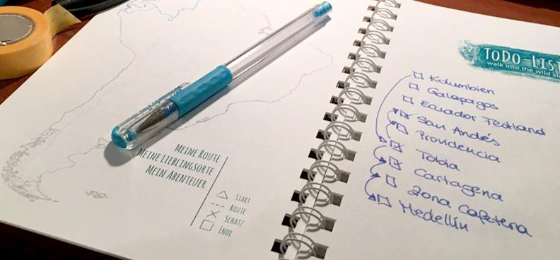 Stift auf Reisetagebuch mit Todo-liste